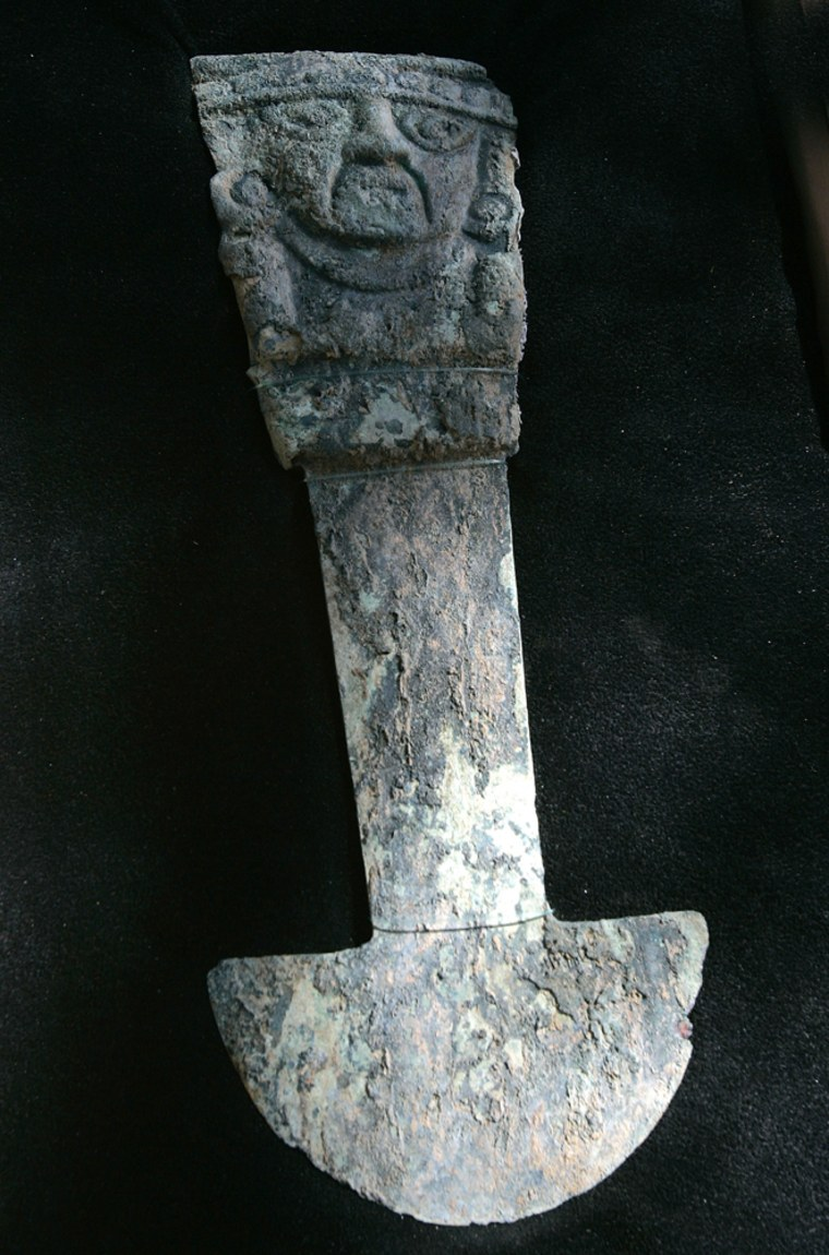 """A 14-inch (34-centimeter) """"tumi,"""" a ceremonial knife made of copper alloy, is presented in Ferrenafe, Peru on Tuesday. Archaeologists in northern Peru say the artifacts found next to a pyramid in northern Peru include the first pre-Inca tumi knives ever excavated scientifically."""
