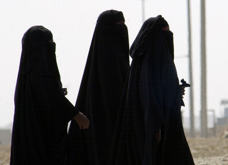 Unidentified Saudi women walk in Riyadh, Saudi Arabia in this Nov. 15 photo. The kingdom's judicial system, particularly the wide latitude judges have in sentencing criminals, has come under scrutinyafter the gang rape of a 19-year-old woman and her male friend.