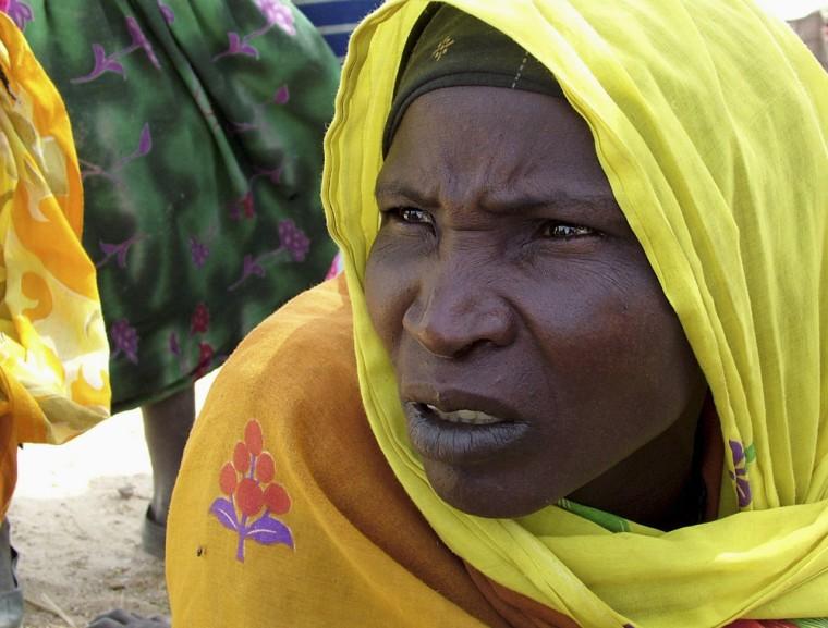 A Sudanese refugee sits in Seneit near the Chad/Sudan border