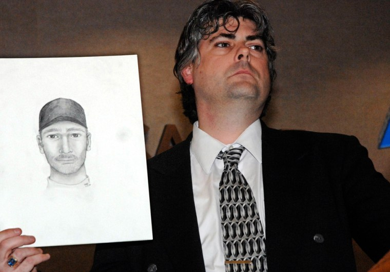 Police detective Sgt. Marc Simmons holds a sketch of a possible murder suspect during a press conference in the town of Newcastle, N.Y., near the Chappaqua residence of former President Bill Clinton, on Monday.