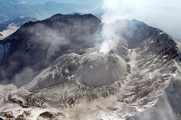 In this photo provided by the U.S. Geological Survey's Cascades Volcano Observatory, Mount St. Helens' crater, dome and west arm of the crater glacier are shown as seen from the west on Sept. 12.