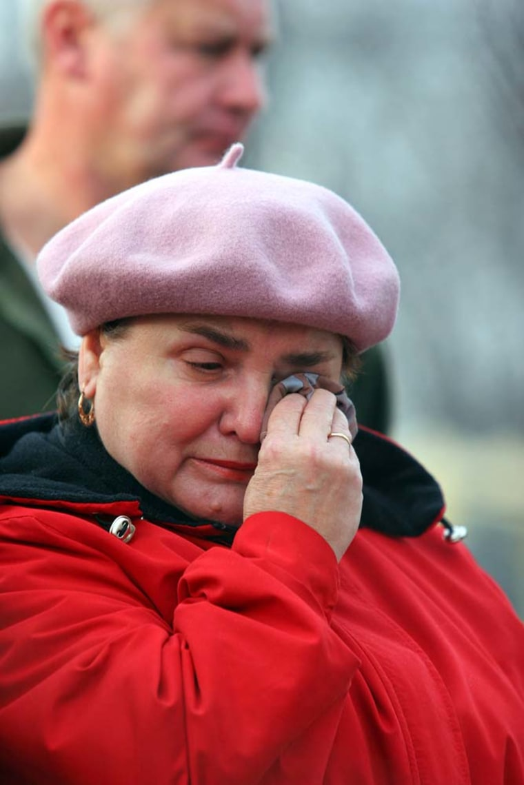 A woman cries in front of the Halemba coal mine, in Ruda Slaska, Poland, on Thursday, after 23 miners died in a mining accident.