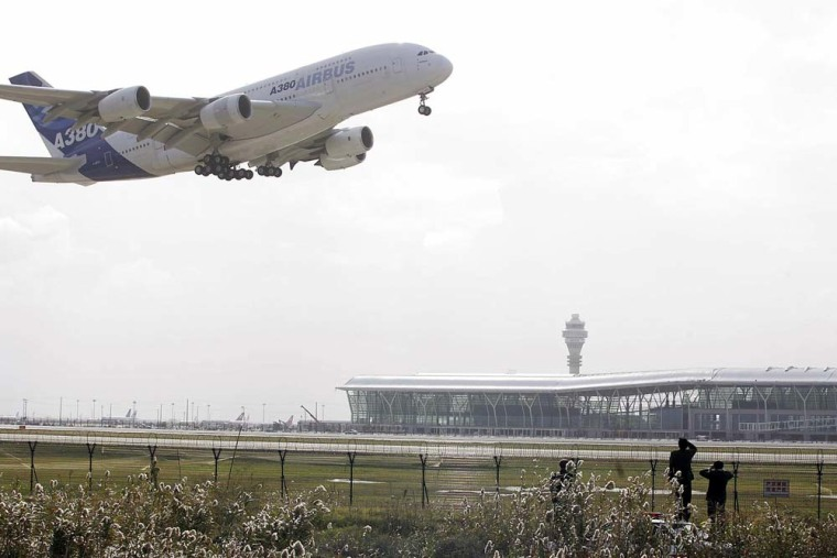 An Airbus A380 takes off from Shanghai Pudong airport in Shanghai, China Friday as part of the process of winning its air-worthiness certification.