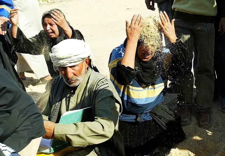 Victims Of Bomb Attacks Buried In Najaf, Iraq