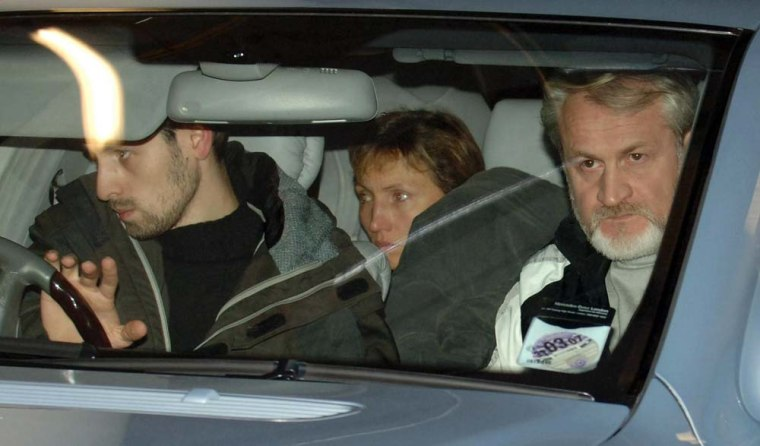 Marina, center, thewife of former Russian spy Alexander Litvinenko,leaves University College Hospital in London, accompanied by Chechen Foreign Minister Akhmed Zakayev following the announcement of her husband's death on Thursday night.