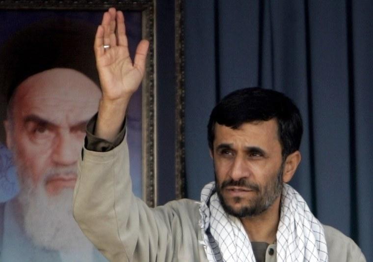 Iranian President Ahmadinejad waves to Basij paramilitary volunteers during parade ceremony in Tehran