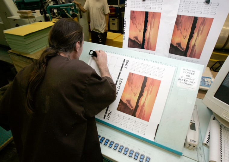 An inmate checks the quality of a calendar being printed at the Maryland Department of Corrections in Jessup, Md., Sept. 6, 2006.