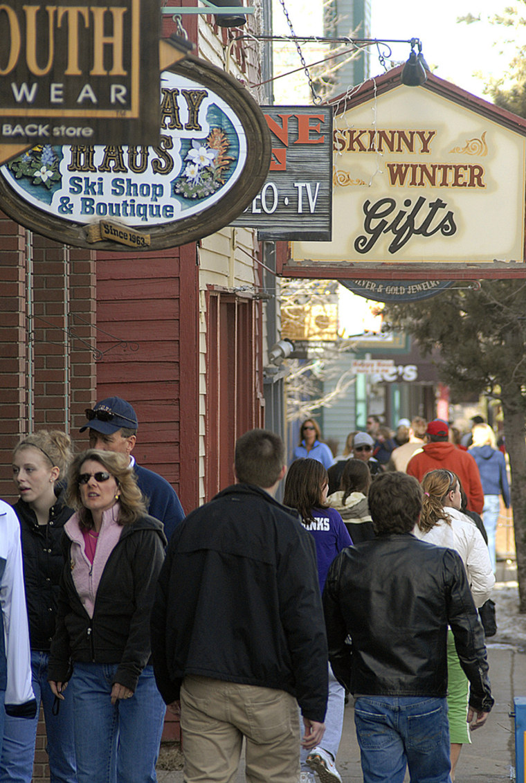 Shoppers walk Main Street in Breckenridge, Colo., earlier this month. Resort retailers cater to tourists during the busy ski season, which starts around Thanksgiving for Colorado resorts and ends in late March.