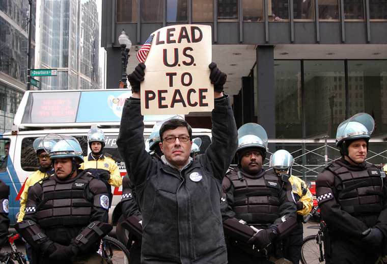 Malachi Ritscher holds up a sign during an antiwar protest in Chicago in this photo from April 2003. On Nov. 3, Ritscher set up a video camera, doused himself with gasoline and lit himself on fire on expressway off-ramp in downtown Chicago. War protesters are hailing him as a martyr.