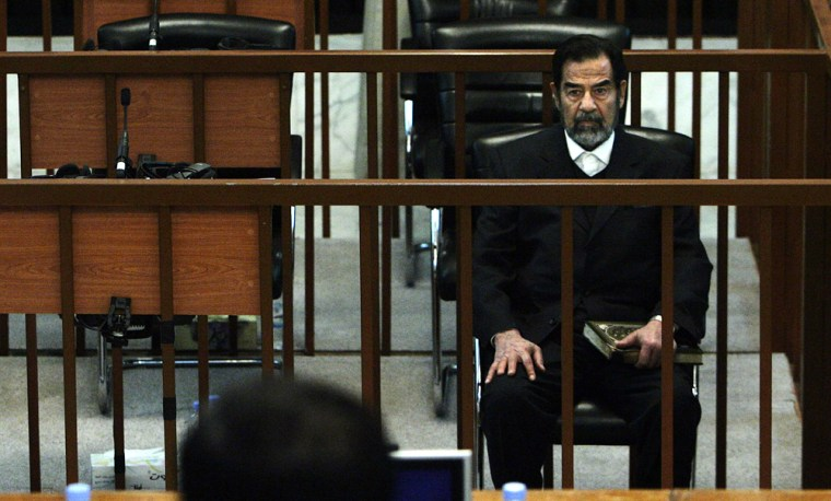 Saddam Hussein sits in court during his trial on Monday after a 19-day break. Saddam and his co-defendants have pleaded innocent to charges of war crimes and crimes against humanity for their role in the military offensive against the Kurds, known as Operation Anfal.