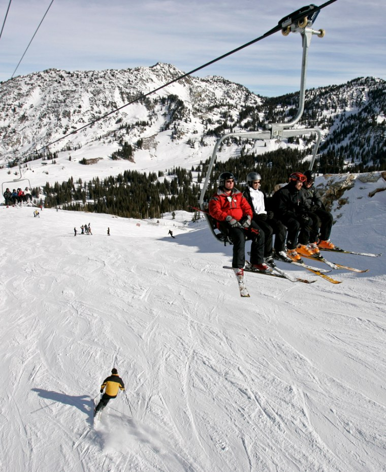 Skiers take the lift up as other take the slope down at Alta Ski Resort on Nov. 19, 2006, in Alta, Utah.