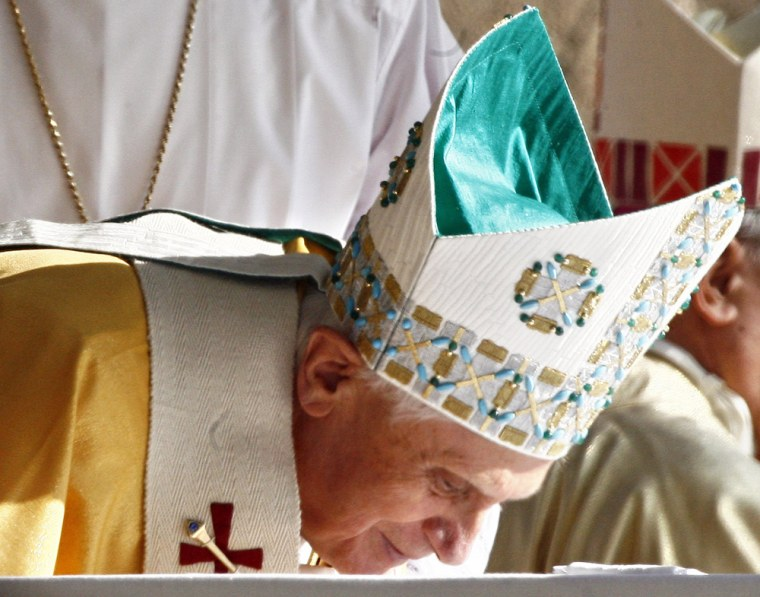 Pope Benedict XVI kisses the altar at the end of a mass in front of 'Mary's House' near Ephesus