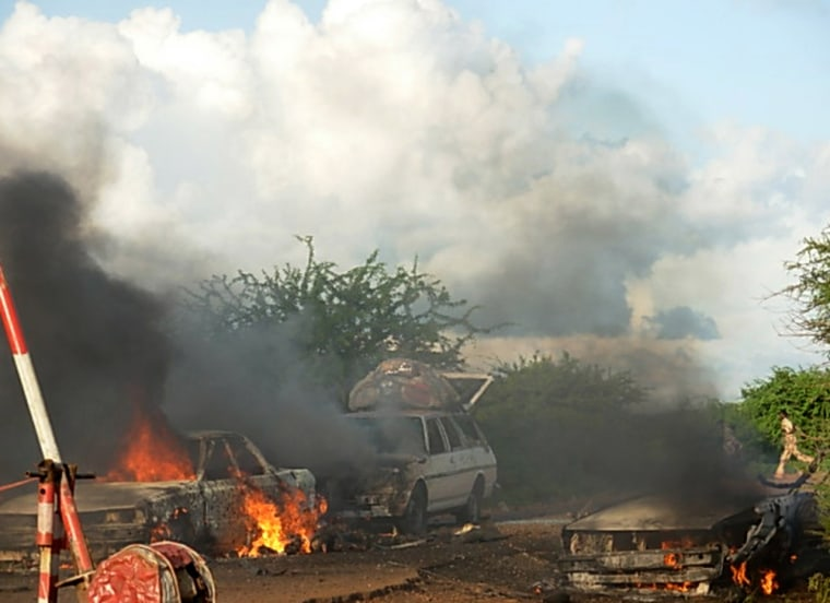 Cars burn Thursday after a bomb exploded at a checkpoint in Baidoa, Somalia.