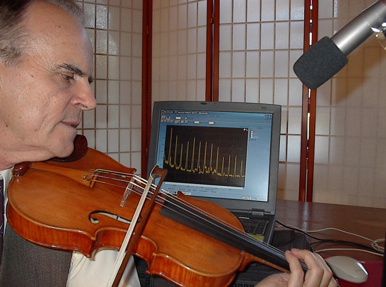 Texas A&M researcher Joseph Nagyvary bows a new violin produced using the Cremona method of wood preservation. The sound quality of these violins is tested using fast Fourier transform analysis.