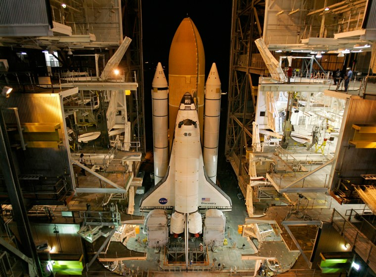 The space shuttle Discovery rolls out from the Vehicle Assembly Building at NASA's Kennedy Space Center in Florida in November, on its way to Launch Pad 39B. Months of preparation are leading up to Thursday's launch, the shuttle program's first nighttime blastoff in four years.