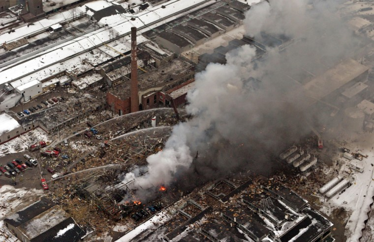 Milwaukee firefighters battle a five-alarm blaze after an explosion Wednesday at the Falk Corp. in Milwaukee. The blast killed three people and injured46 more.