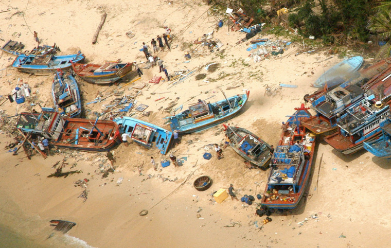 Fishing boats were washed ashore after Tropical Storm Durian tore through Phu Quy island off the coast of Binh Thuan province, Vietnam, on Tuesday.