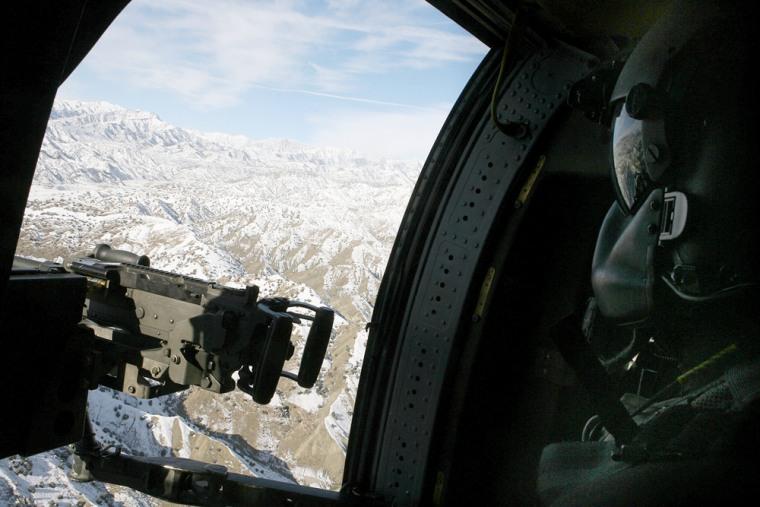 A US Blackhawk door-gunner loks out over
