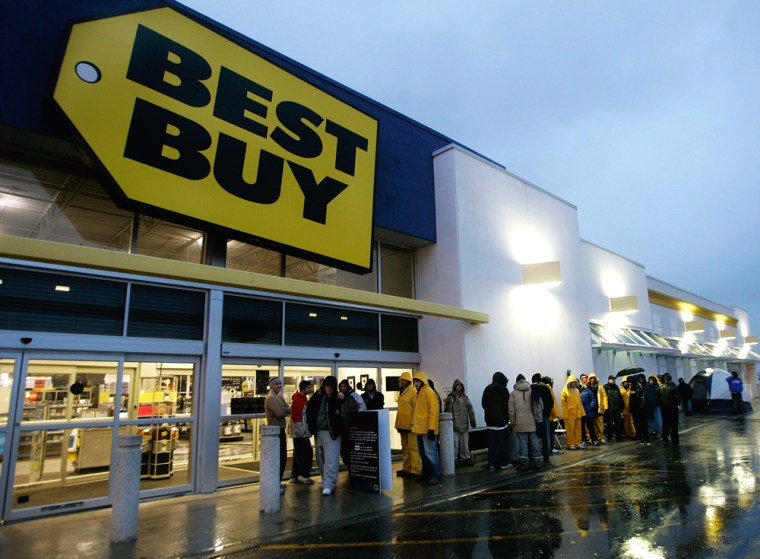 People wait in line earlyNov. 17 to buy a new Sony Playstation 3 at a Best Buy in Toronto. Two R.I. police officers are being investigated for allegedly using their influence to skip ahead in line at an area Sony store on launch day.