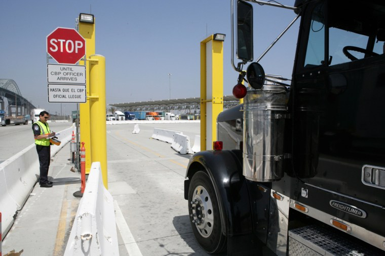 A Customs and Border Protection officer inspects a truck at a port for radioactive material. Cargo containers bound for the United States from six foreign seaports will be screened for dangerous nuclear materials.