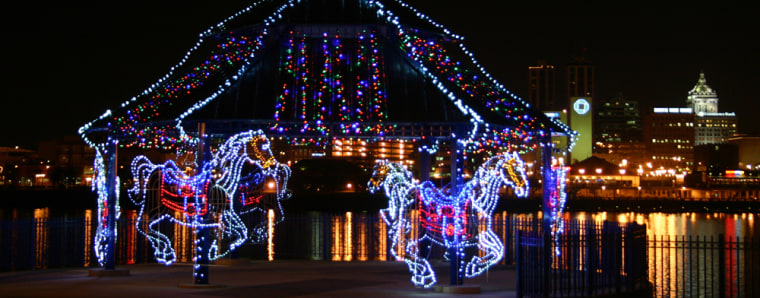 The carousel display in the new Folepis RiverFront Promenade is seen during the Festival of Lights in East Peoria, Ill. The carousel is animated by synchronized blinking lights, and is attached to a pavilion in the park.