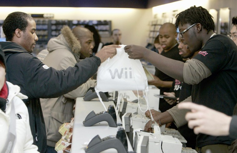 Gaming fans purchase a Wii Nintendo cons