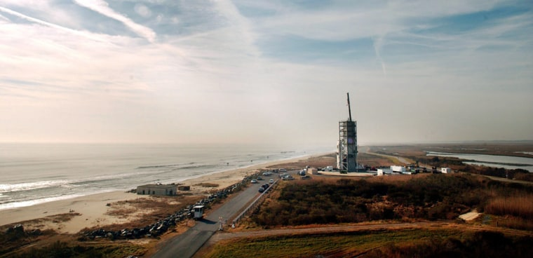 Surrounded by a gantry to protect it from the elements, the Minotaur I rocket, carrying a small experimental satellite for the Air Force and an even smaller one for NASA, sits on the launch pad at the Mid-Atlantic Regional Spaceport on Wallops Island, Va.