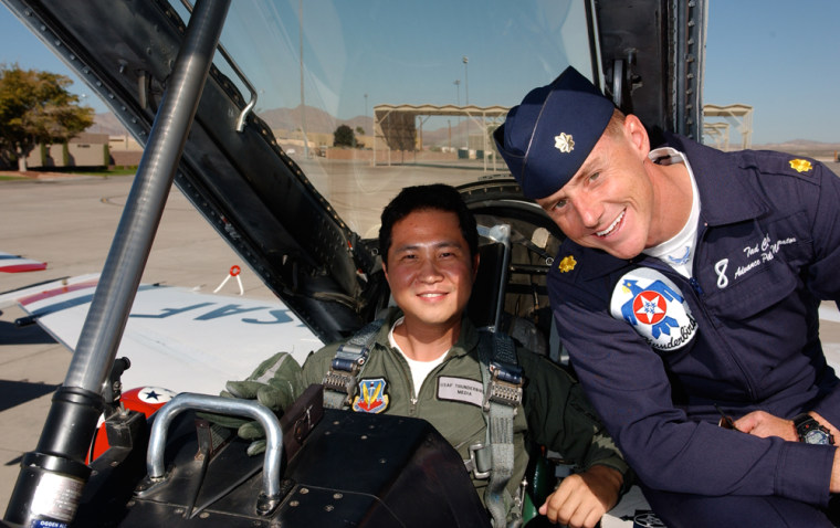 "NBC News' Gene Choo and Maj. Tad ""T.C."" Clark, pilot of Thunderbird 8, prepare for take-off at Nellis AFB in Las Vegas."