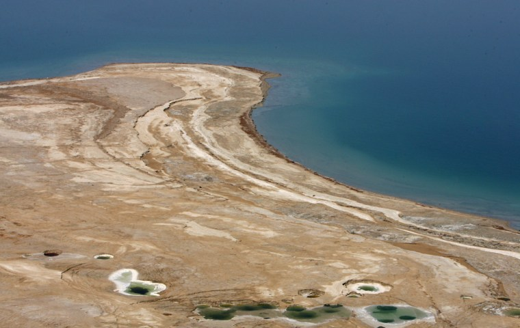 Traces of water are seen where the Dead Sea once reached, June 20, 2006.