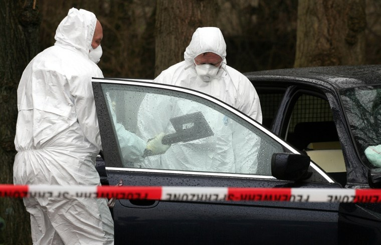 Investigators examine a car on an estate in Haselau, west of Hamburg, Germany, on Monday. Traces of radiation found at sites in Germany linked to a contact of poisoned former Russian spy Alexander Litvinenko likely are the rare radioactive substance polonium-210, authorities said Sunday.