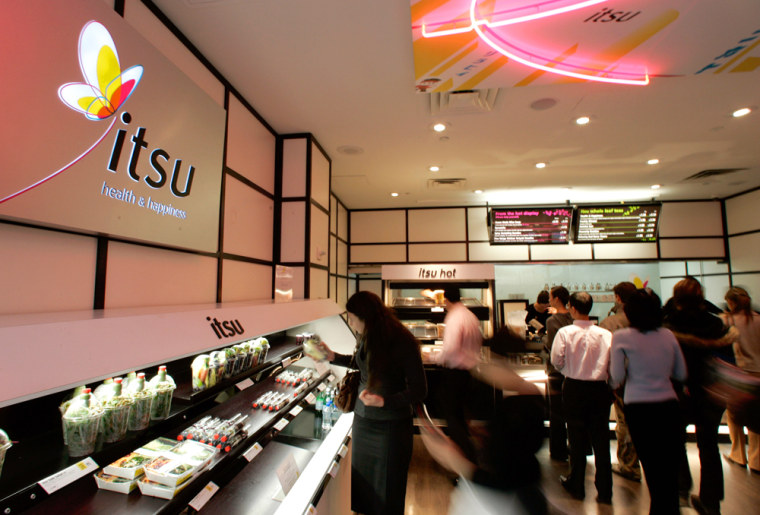 Patrons move around the Itsu restaurant in New York City on Tuesday. The new sushi restaurant didn't need to spend much for advertising and generating buzz before it opened this week.