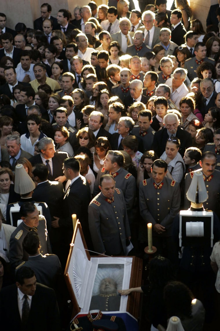 Supporters of former military ruler Gen. Augusto Pinochet attend a Mass at the Military Academy in Santiago onMonday. Pinochet, who ruled Chile from 1973 to 1990 after a military coup, died Sunday from heart complications at the age of 91.
