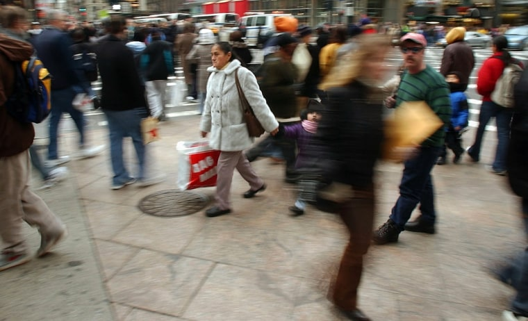 Shoppers pack New York's 34h Street in a December2003 file photo. The city of 8.2 million is expected to grow by at least 1 million people over the next 25 years.
