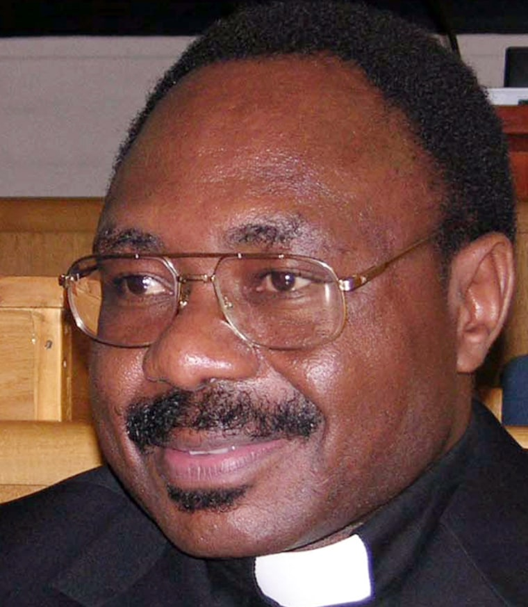 Seromba, former Rwandan Catholic priest, sits in the dock at the International Crinial Tribunal for Rwanda (ICTR) in Arusha