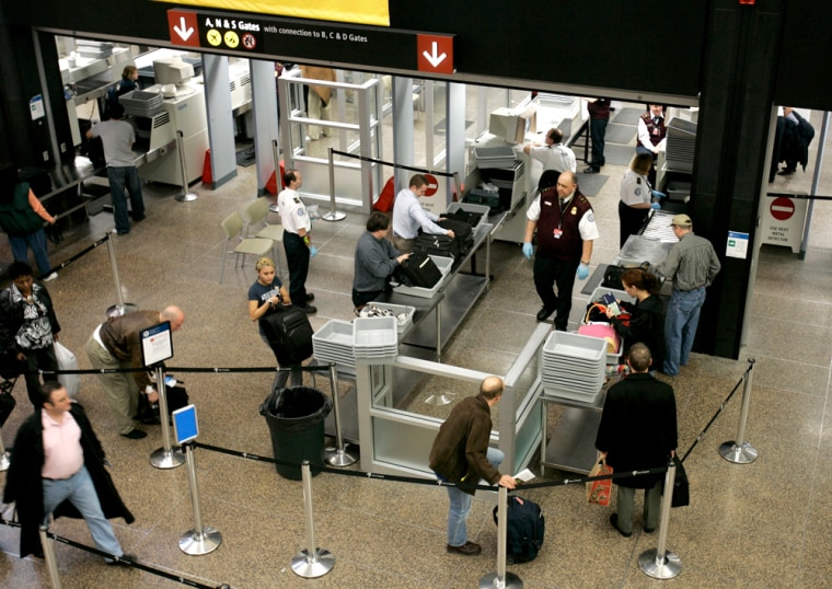 People make their way through security at Seattle-Tacoma International Airport Monday earlier this month. Travelers can expect longer lines as passenger volumes increase as the holidays approach.