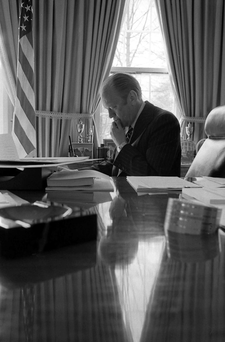 File photo of former US President Ford sitting in the Oval Office