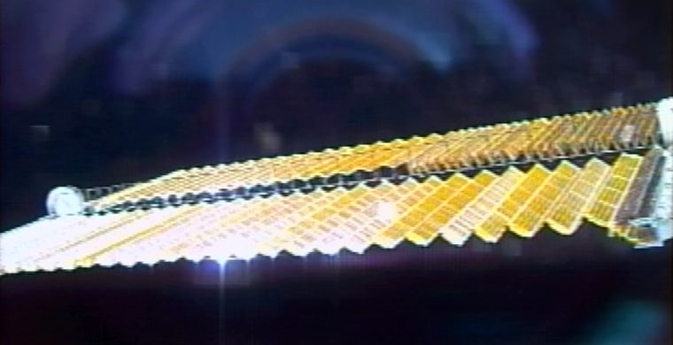 A view from orbit shows the international space station's half-folded-upsolar array Friday.