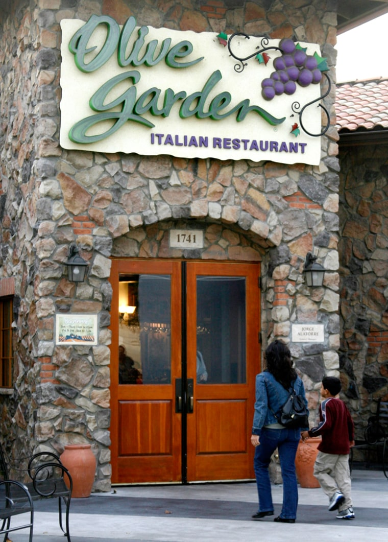Customers are shown outside an Olive Garden restaurant in Burbank,California