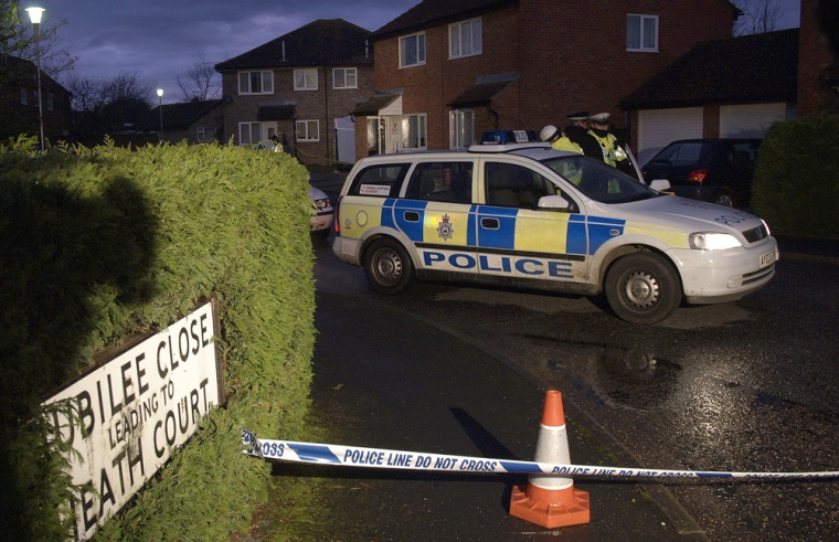 A police car is parked at dawn outside the home of an arrested 37-year-old man in Trimley St. Martin, east of Ipswich, Eastern England, on Tuesday. Police reported that a second man was arrested in connection with the murder of five women in the town recently.