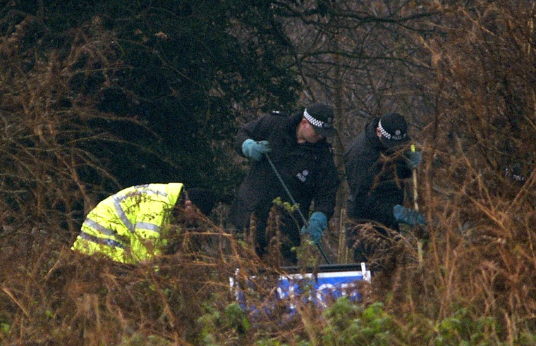 British police officers look for clues in a wooded areanear where the bodies of murdered prostitutes Paula Clennell and Annette Nicholls were found on Dec. 12 near Levington, England.