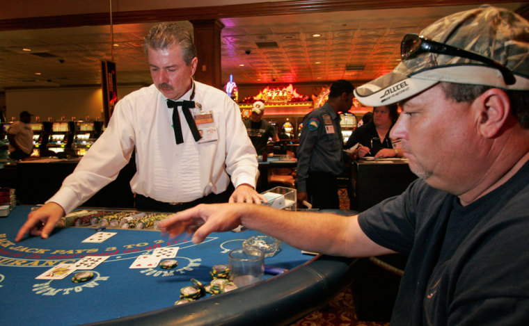 Darren White from Douglas, Ga., helps contribute to the Gulf Coast Casino business by playing blackjack at the Boomtown Casino in New Orleans.