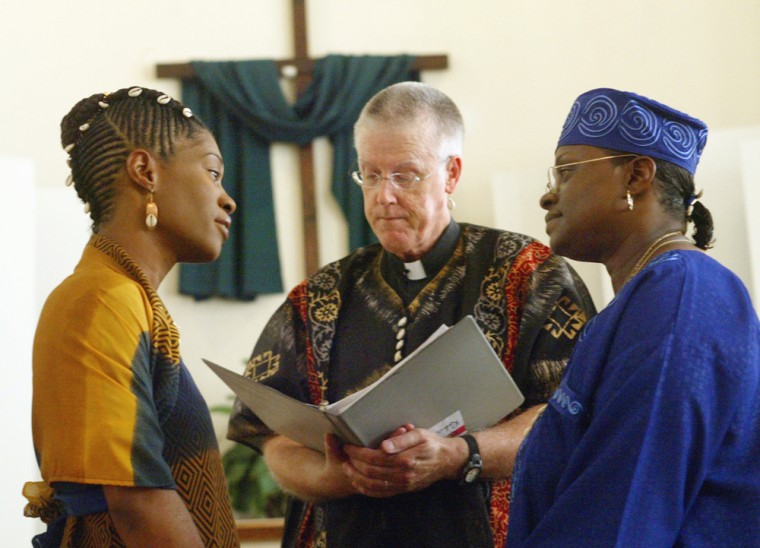 Madeline Jones, left, and Vinyelle White take their vows during their same-sex wedding at the Metropolitan Church in Richmond, Va. The African-themed ceremony is not recognized in the eyes of the state.