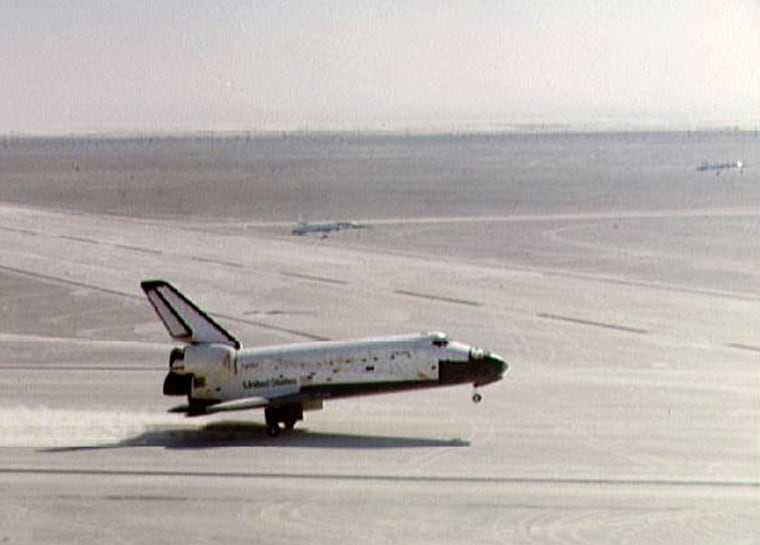 The shuttle Columbia touches down on the Northrop Strip at White Sands in New Mexicoon March 30,1982, trailing gypsumpowder behind it.