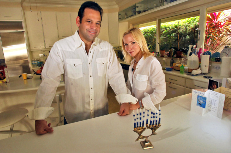 Andy Rudnick, 42, founder the Matzo Ball, poses with his wife, Catherine, 33, in their Boca Raton, Fla., home on Saturday. The Matzo Ball and other night-before-Christmas parties thrown largely by Jewish organizers are giving non-celebrants a tradition of their own.