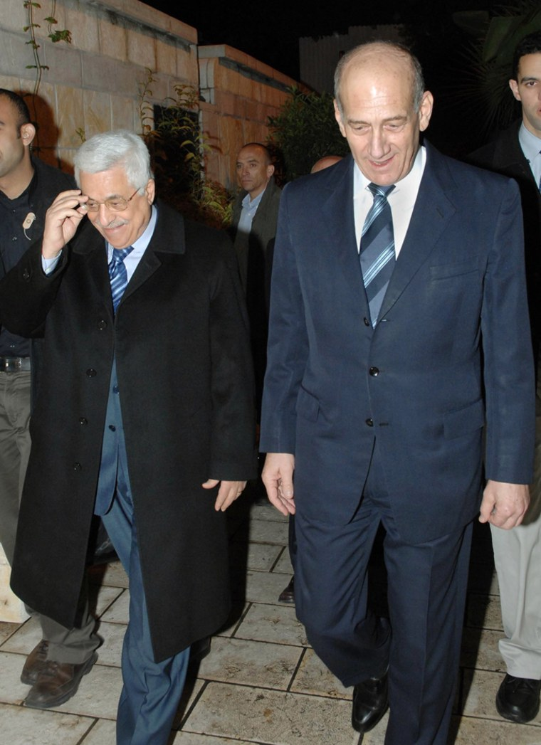 Israeli Prime Minister Ehud Olmert, right, walks with Palestinian Authority President Mahmoud Abbas prior to a meeting at Olmert's official residence in Jerusalem on Saturday.