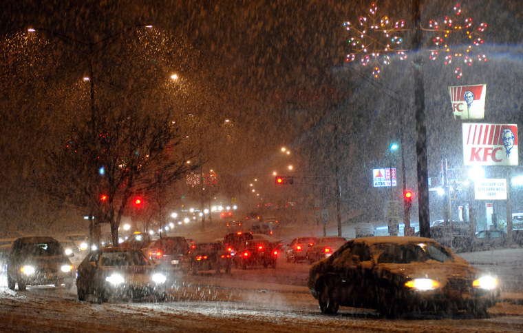 Rain turned to snow in Wausau, Wis., on Friday and continued to fall on Saturday, knocking out power to thousands.