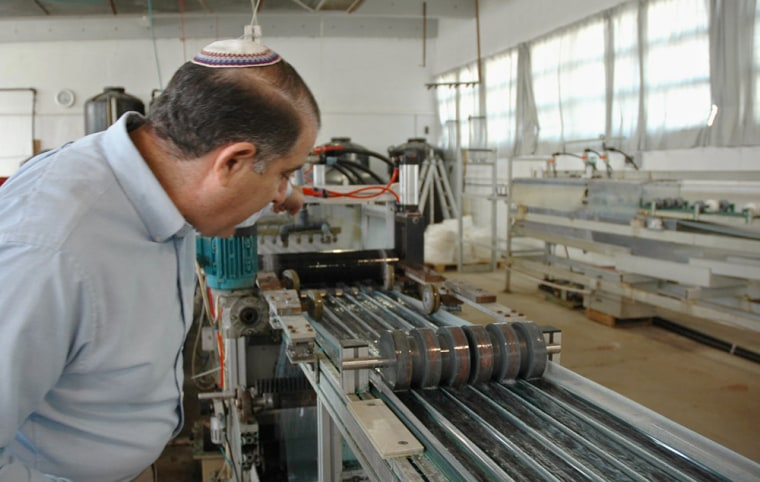 """Jeffery Gabbay's factory in Beit Shemesh, near Jerusalem, turns out fabric """"impregnated"""" with copper oxide. Some think the substance helps heal skin disorders."""