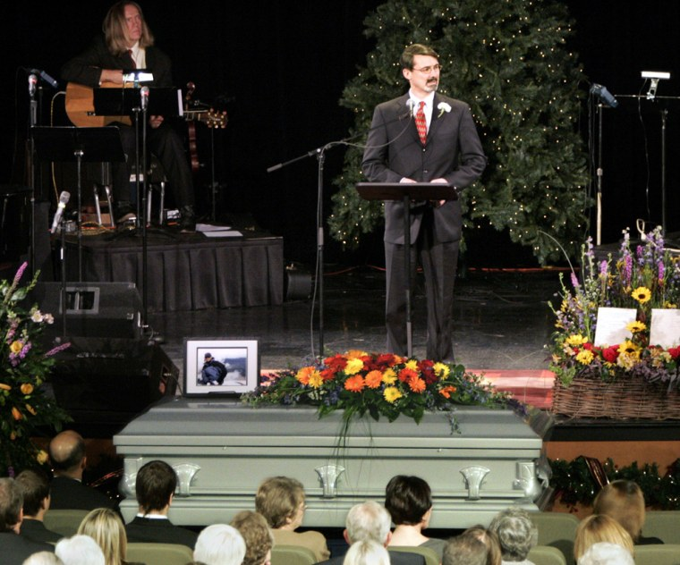 Frank James delivers a eulogy for his brother Kelly, who died climbing Oregon's Mount Hood, on Wednesday in Dallas.
