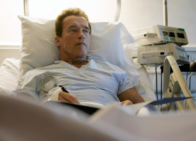 Gov. Arnold Schwarzenegger, R-Calif., liesin his hospital room in Santa Monica, Calif., on Thursday recovering from leg surgery that followed a skiing accident in Idaho.