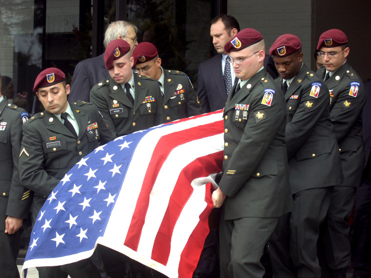 Members of the U.S. Army Garrison HHC from Fort Polk, La., carry the casket of Army Staff Sgt. Jacob Gerald McMillan after a funeral service Friday at Lafayette Memorial Park Cemetery in Lafayette, La. McMillan died in Iraq on Dec. 20 from wounds he suffered when a roadside bomb exploded near his vehicle.